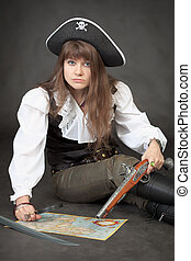 Woman - pirate with sea map and pistol on a black background