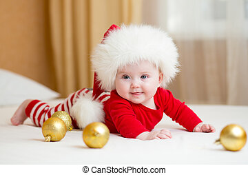 funny Santa baby girl lying on white bed