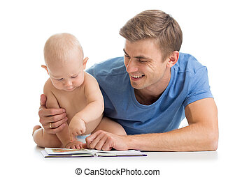 father reading a book to son baby