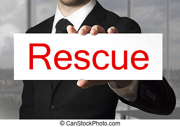 businessman showing sign rescue - businessman in black suit...