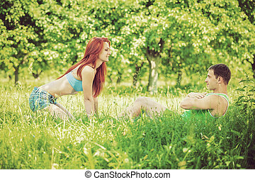 young couple press up on nature instagram stile
