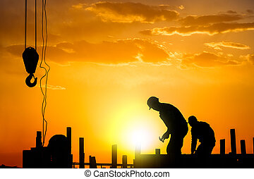 silhouette of construction worker - silhouette of...