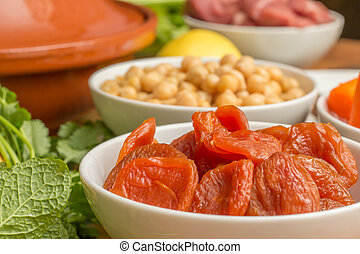 Ingredients for a Moroccan dish with dried apricots -...