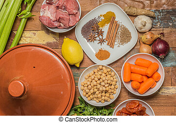 Ingredients for a Moroccan dish with lamb and vegetables -...