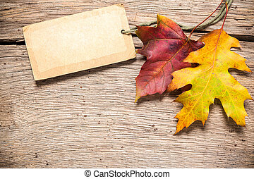 Sale tag with maple leaves - Autumn or fall sale tag with...