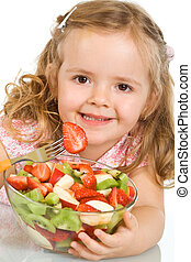 Happy little girl with a large bowl of fruit salad - Happy...