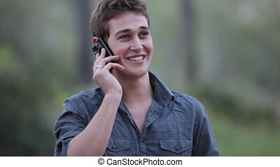 Phone call - Casual young man receiving a phone call on his...