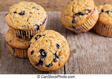 Healthy blueberry banana muffins on a wooden table