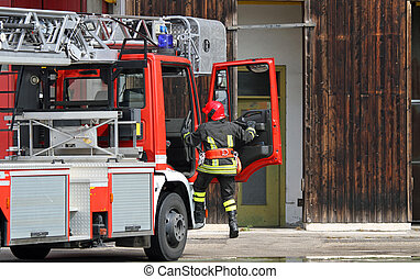 fire truck with a firefighter during an emergency call -...