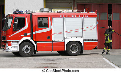 Italian firefighter during exercise in fire station - fire...