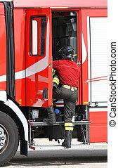 firefighter near the fire truck when handling an emergency -...