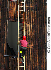 fireman during a demonstration of using the ladder to reach the