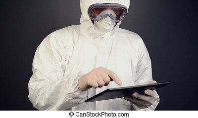 Chemical scientist using tablet
