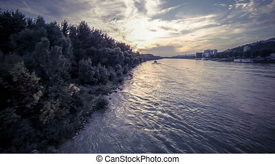 Sun over river aerial footage
