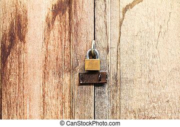 Lock on old wooden door.