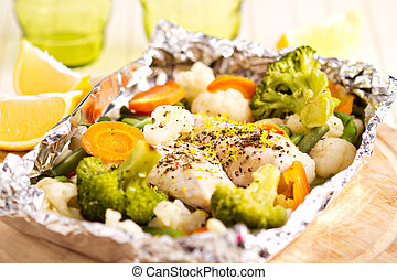 Lemon chicken with vegetables cooked in foil