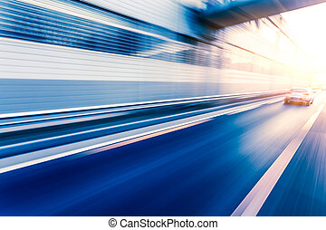 Car driving on freeway at sunset, motion blur - Car driving...