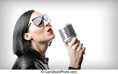 Singer with microphone - Beautiful singer with microphone in...