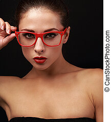 Sexy makeup woman in red eyes glasses looking. Closeup on...
