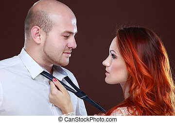 Portrait of a young beautiful couple in studio