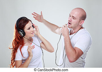 A young man and girl listen music