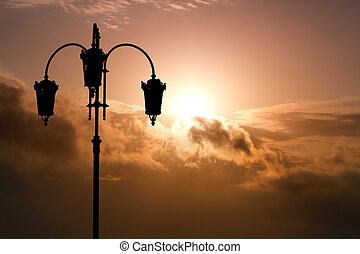 Silhouette of black street lamp against the background...
