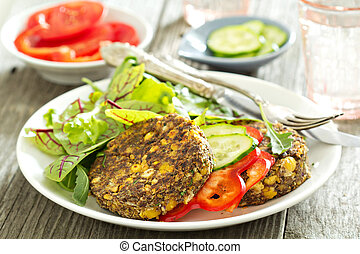 Vegan chickpeas burgers with salad and vegetables