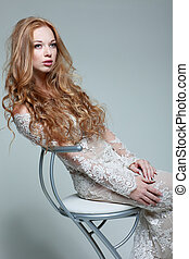 A portrait of stylish elegant redheaded girl is in lace...