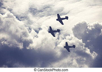 Fighter planes on cloudy sky - Old fighter planes on bright...