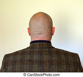 photo of the back side of a businessmans head