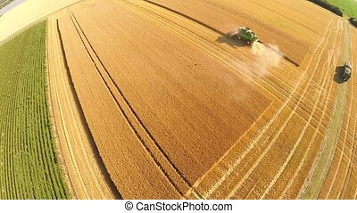 Aerial of a harvested grainfield - aerial video footage of a...
