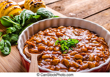 Spicy cowboy beans with hassleback potatoe with herbs -...