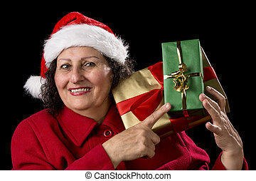Senior Lady with Santa Cap Points at Wrapped Gifts - Elderly...