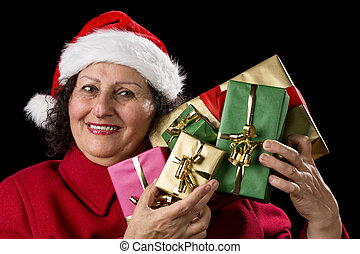 Mature Lady Holding Up Five Christmas Presents - Senior lady...