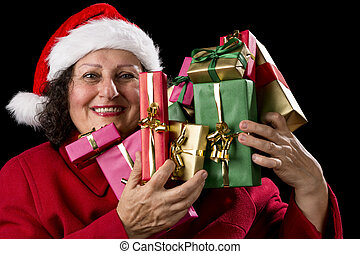 Happy Female Senior Lifting Many Wrapped Presents - Smiling...