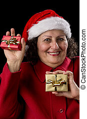 Happy Old Woman with Santa Hat and Two Xmas Gifts - Smiling...