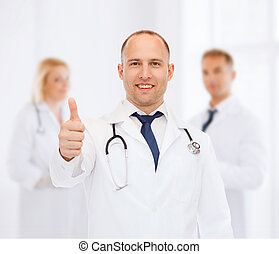 smiling male doctor with stethoscope - profession, teamwork,...