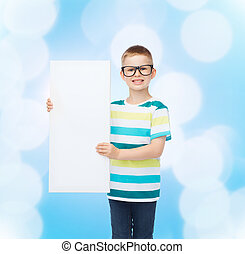 smiling boy in eyeglasses with white blank board - vision,...