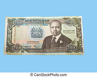 a two hundred kenyan shilling note on a bright blue...