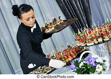 Waiter serving catering table - Waiter with meat dish...