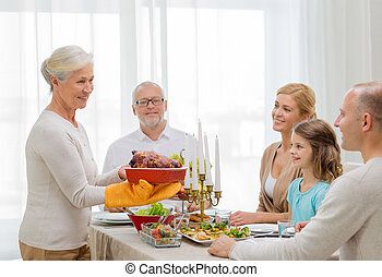 smiling family having holiday dinner at home - family,...