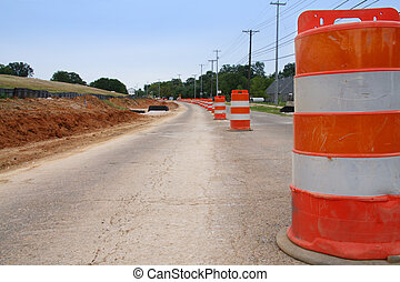 Road Construction - A row of traffic cones indicate road...