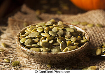 Raw Organic Pumpkin Pepita Seeds in a Bowl