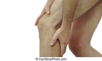 Male Rubs His Knee Joint Pain - Close up shot of an...