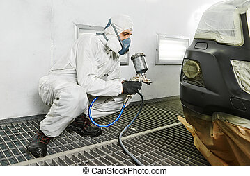 car repair painting in chamber - automobile repairman...