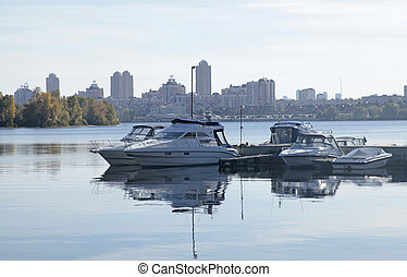 boats on the Dnieper River in Kiev, Ukraine Autumn sunny day...