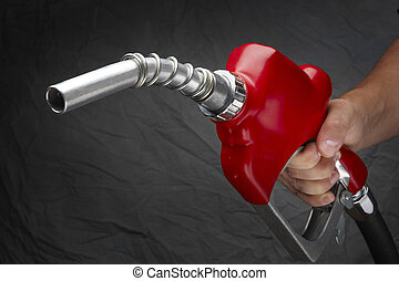 Fill up - Man with gas nozzle in hand at gas station