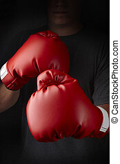 Knockout - Boxer with red boxing gloves about to throw a...