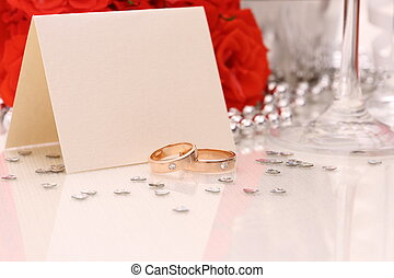 Two golden wedding rings with card, red roses - Two golden...