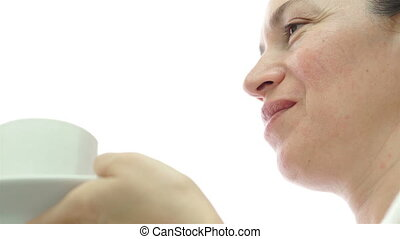 Female Sipping Coffee Low Angle - Low angle shot of a middle...